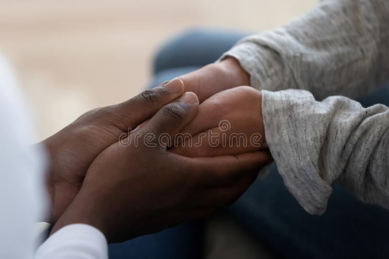 Mixed ethnicity family couple holding hands express support in marriage royalty free stock images