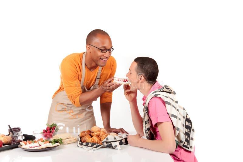 Mixed Ethnicity Gay Couple Kitchen Stock Photo