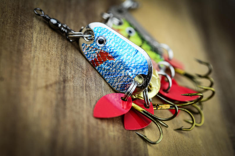 Mixed Fishing Lure And Swiss Army Knife Stock Photo