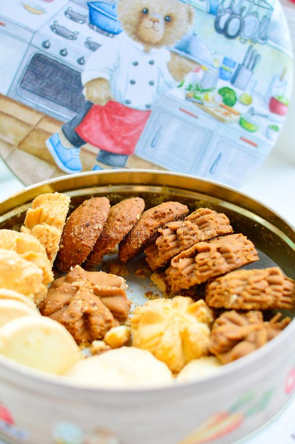 Mixed Flavor Cookies from Hong Kong Jenny Bakery in a Box with Illustration on Lid at Background stock photography