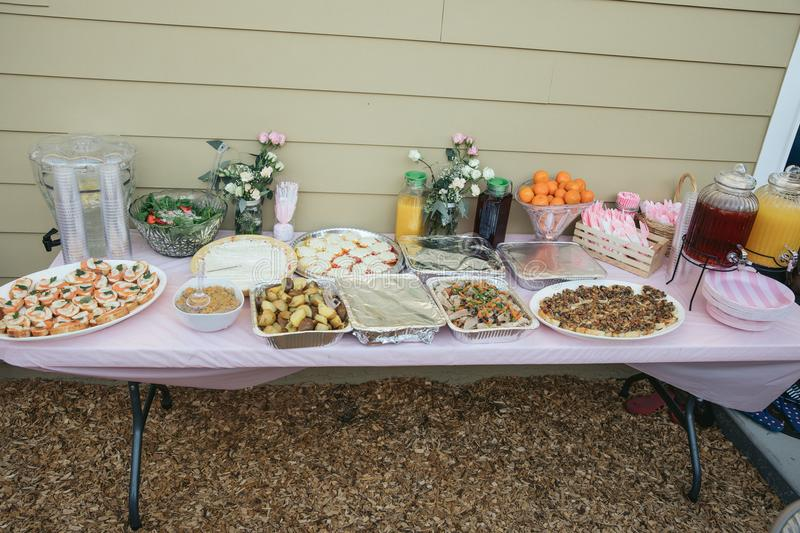 Serving table for celebtate. Table with food. Baby shower royalty free stock photography