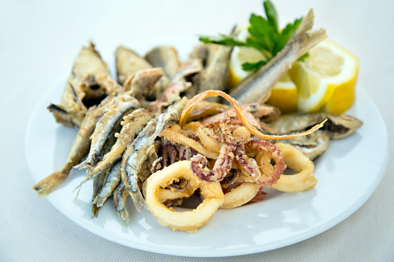 Mixed fried fish. With anchovy, squids and shrimps stock photo
