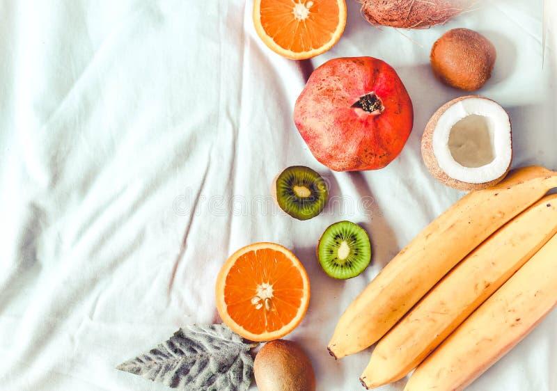 Mixed fruit typical of winter - pomegranates, coconut, kiwi, ora royalty free stock image