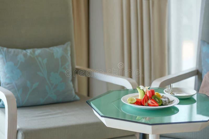 Mixed fruits. Some fruits strawberries, melon, papaya, jackfruit, watermelon, kiwi, dragon fruit and lemons are decorated on plate, Interior design stock image