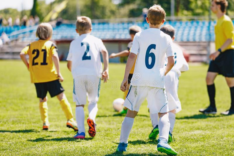 A mixed-gender soccer team playing a football match. Junior soccer tournament game stock images