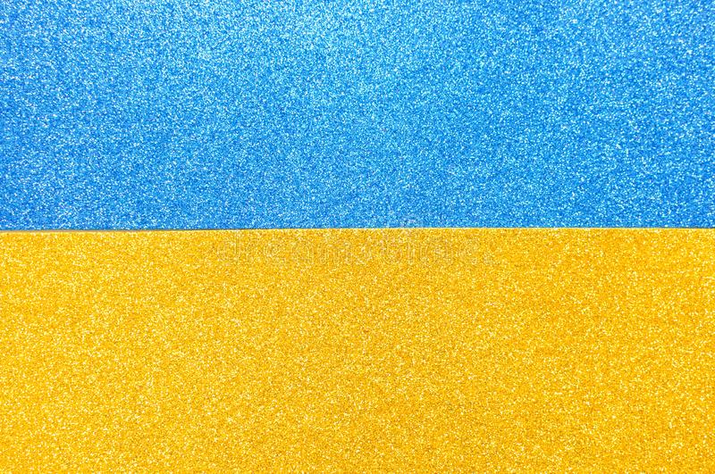 Mixed background glitter texture blue and gold abstract background isolated. Mixed glitter texture blue and gold abstract background stock images