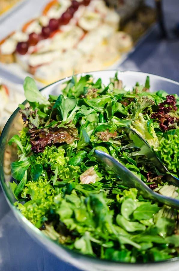 Mixed greens salad. Fresh mixed greens salad and in ceramic bowl stock photos