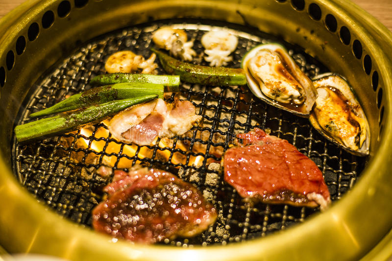 Download Mixed grill on metal grate stock image. Image of mussel - 77168563