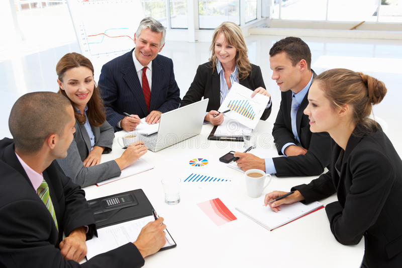 Mixed group in business meeting stock photos