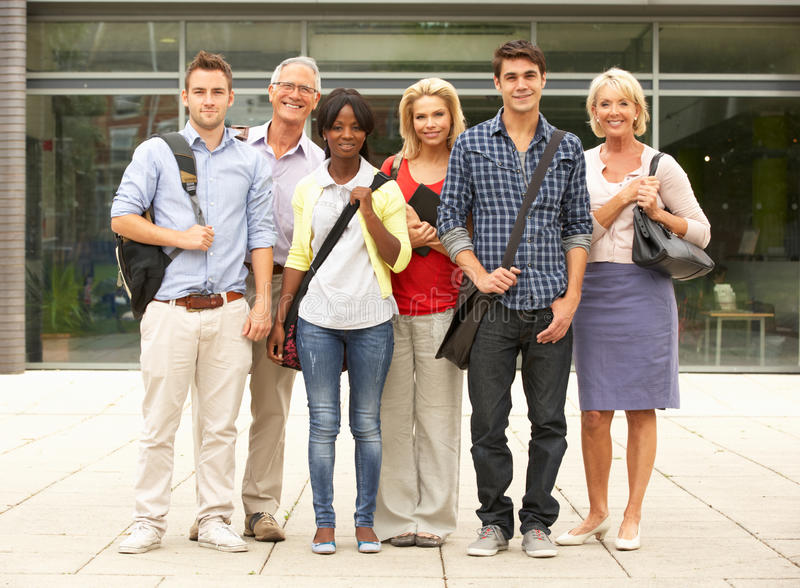 Mixed group of students outside college stock photography