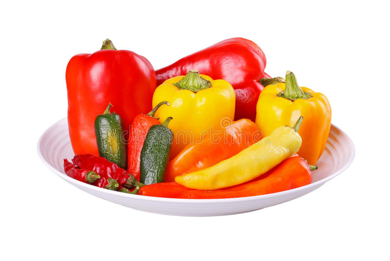 Mixed hot and sweet peppers in a bowl isolated on white stock photo