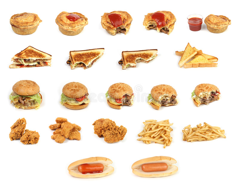 Mixed junk food. Mixed bunch of fast food junk on a white background royalty free stock photo