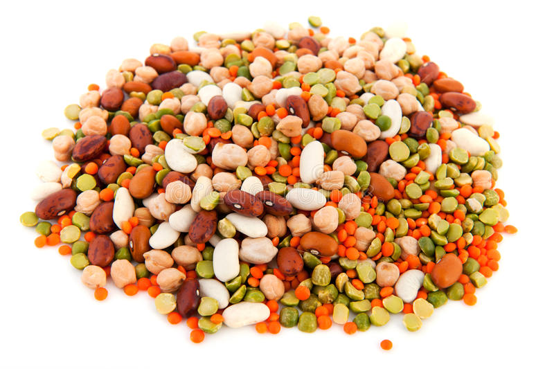 Mixed legumes. Mixed various legumes on white background royalty free stock photo