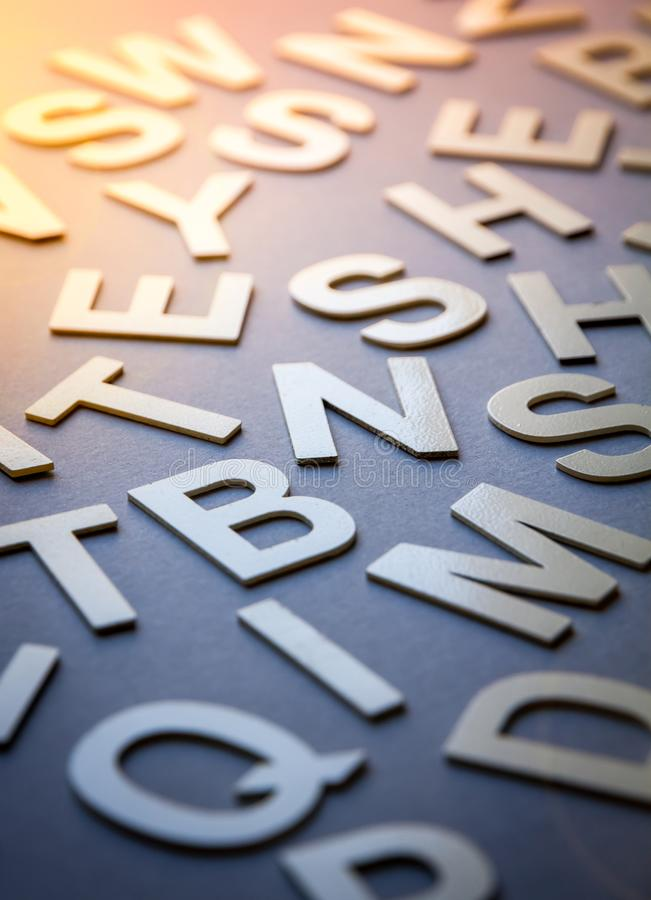 Mixed letters pile closeup photo. Mixed solid letters pile closeup photo. Education background concept royalty free stock photos