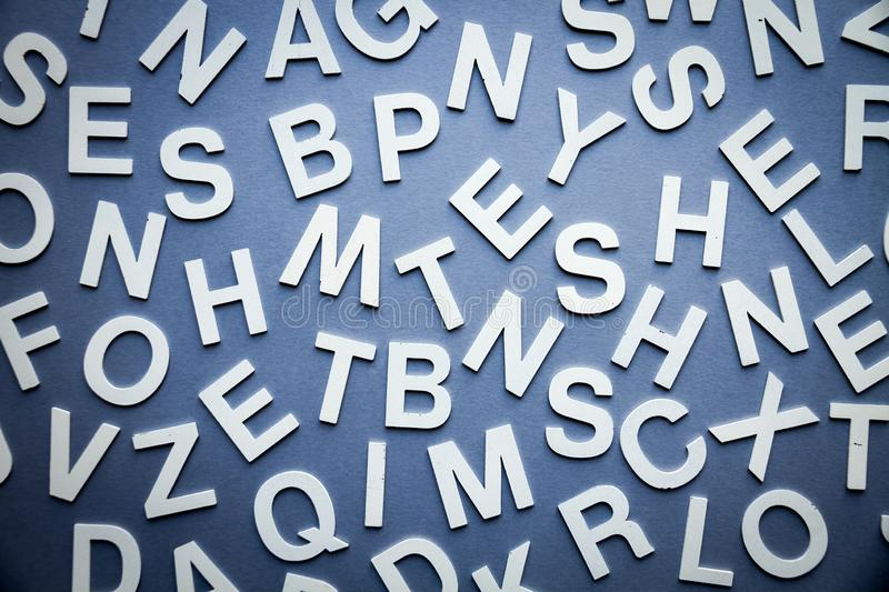 Mixed letters pile top view photo. Mixed solid letters pile top view photo. Education background concept stock photo