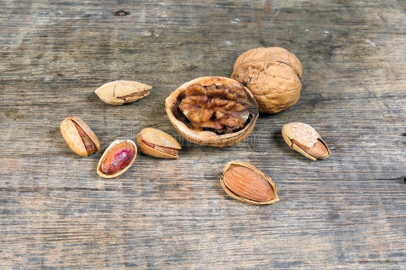 Mixed nut on rustic wood background stock photo