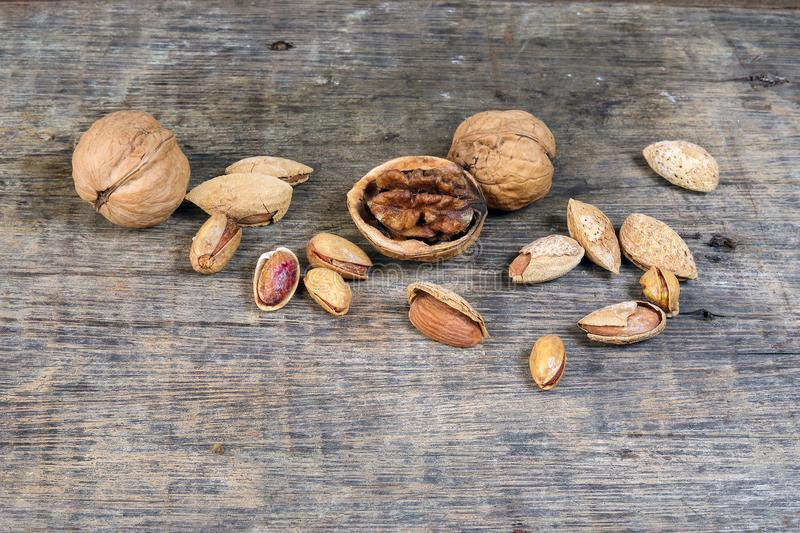 Mixed nut on rustic wood background royalty free stock photo