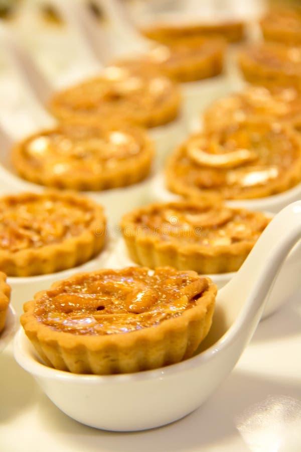 Mixed nut tart in white spoon royalty free stock photos