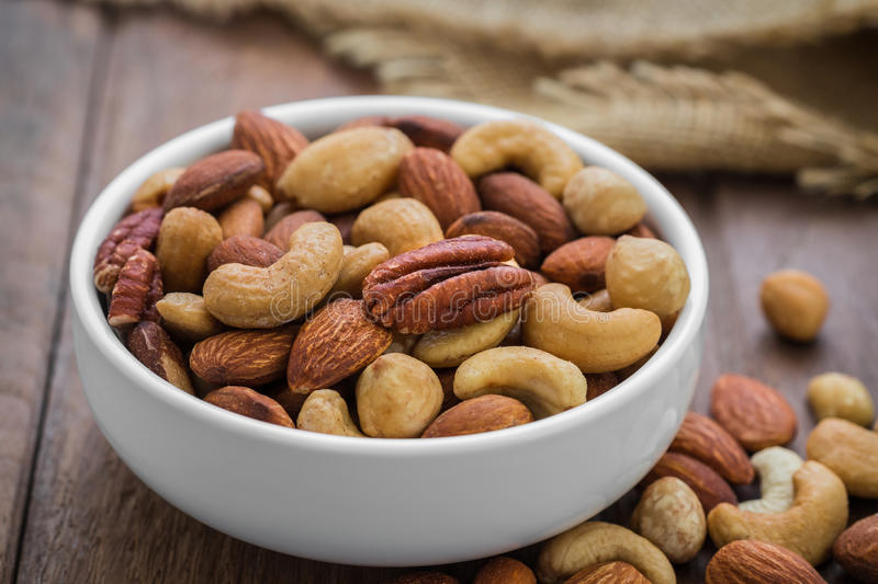 Mixed nuts in bowl royalty free stock photography