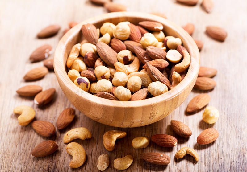 Mixed nuts in a bowl stock photos