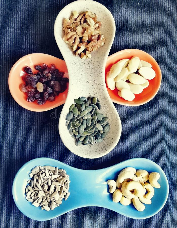 Mixed nuts multicolored. Mixed of nuts composition multicolored stock photos
