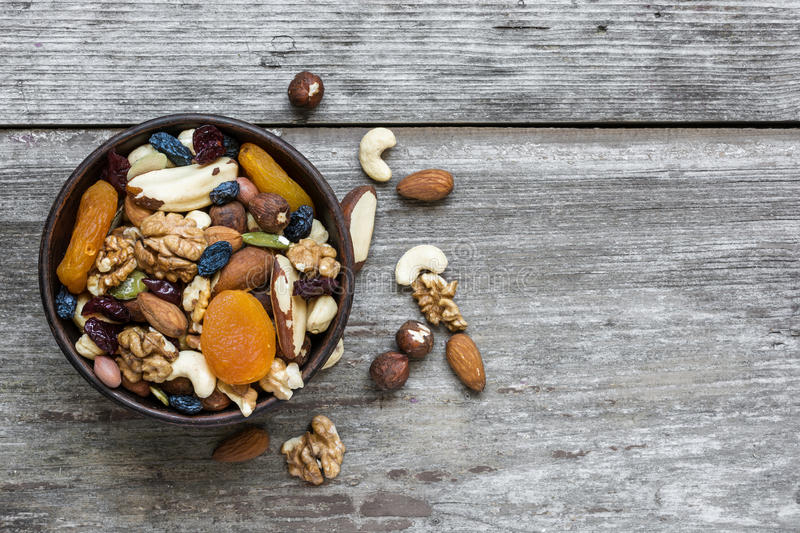 Mixed nuts and dried fruits in a bowl royalty free stock images