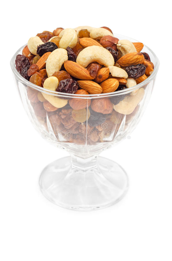 Mixed nuts and dry fruits in glass bowl royalty free stock photos