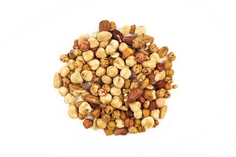Mixed nuts on isolated white background royalty free stock photos