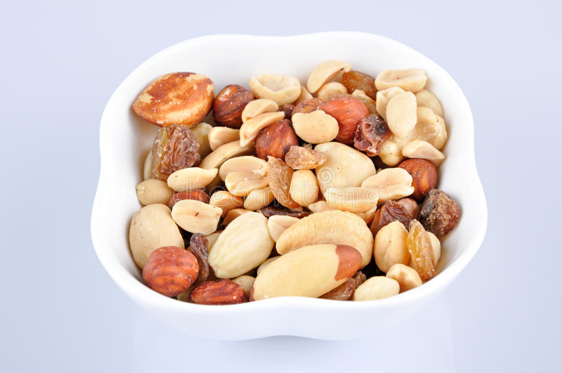 Mixed nuts in a white bowl stock photography
