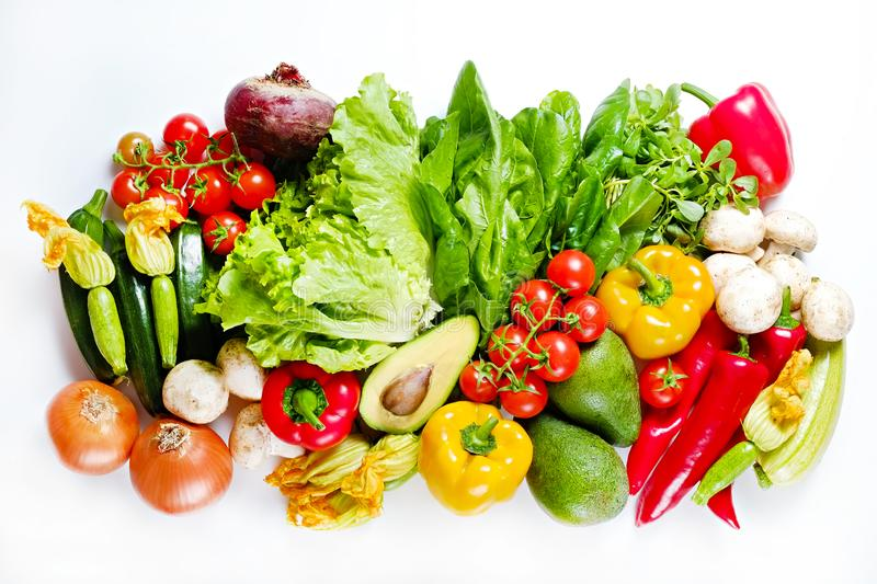 Mixed organic vegetables and greens isolated on white background. stock photos