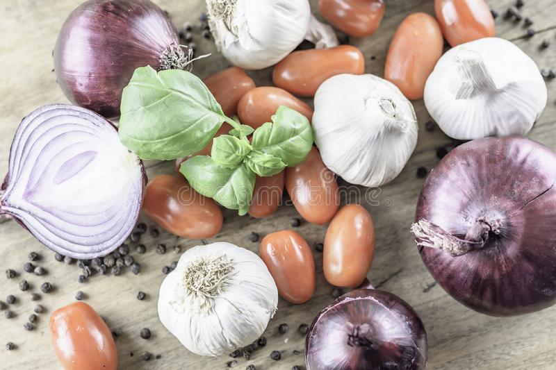 Mixed organic vegetables placed on rustic wooden table.Flat layout image. Italian cooking ingredients.Mixed organic vegetables placed on rustic wooden background royalty free stock photo