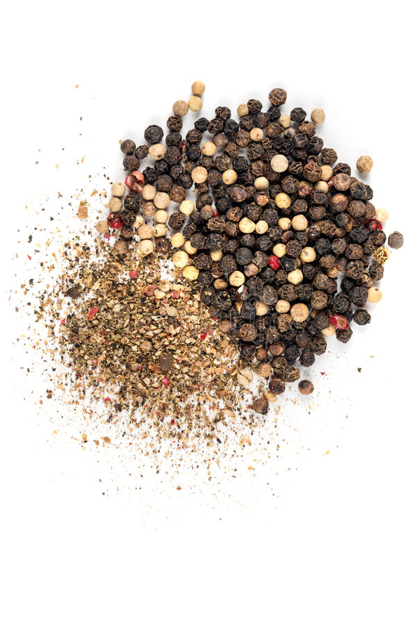 Mixed peppercorns and ground pepper. Isolated on white background stock photos