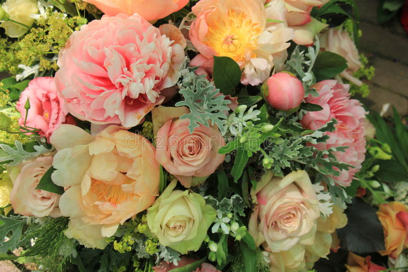 Mixed pink spring bouquet: roses and peonies royalty free stock photography