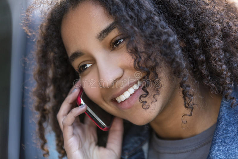 Mixed Race African American Girl Teenager on Cell Phone royalty free stock images