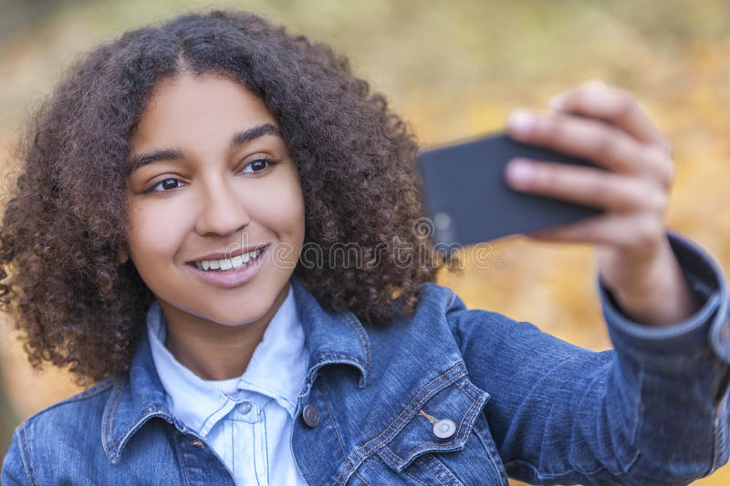 Mixed Race African American Girl Teenager Taking Selfie stock image
