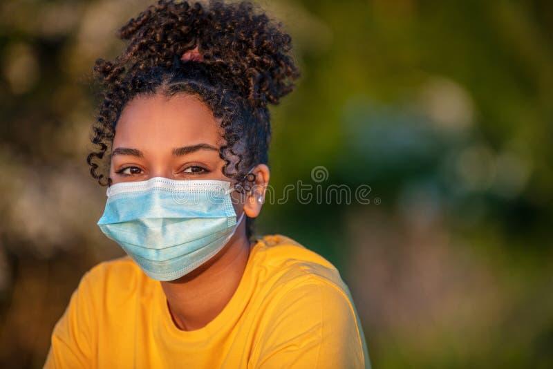 African American Teenager Girl Woman Wearing Coronavirus COVID-19 Face Mask stock photography