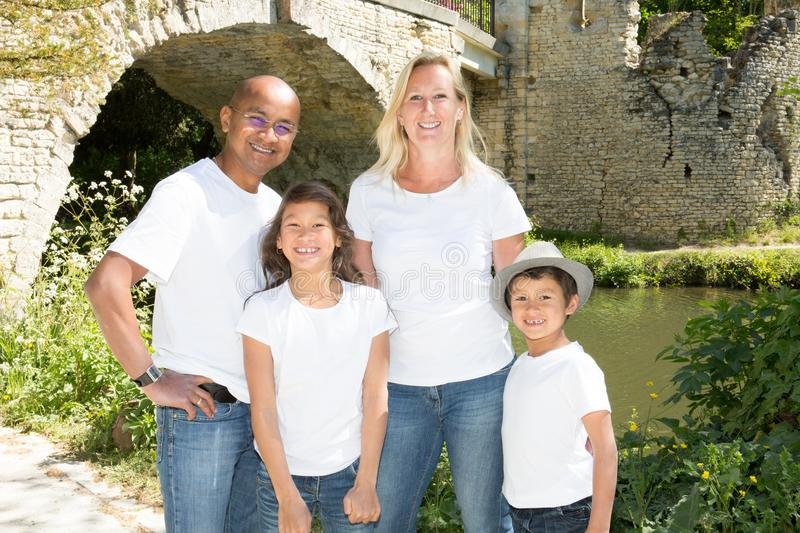 Mixed race american family at park royalty free stock image