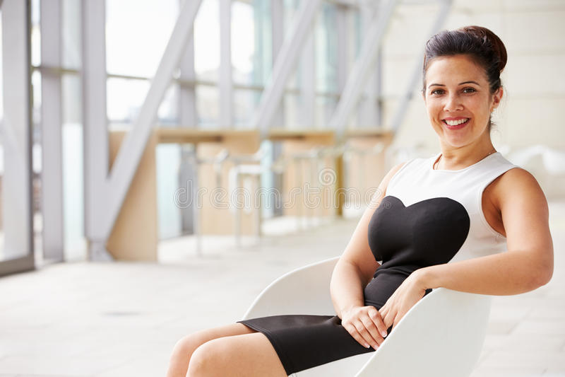 Mixed race Asian businesswoman relaxing, horizontal portrait royalty free stock image