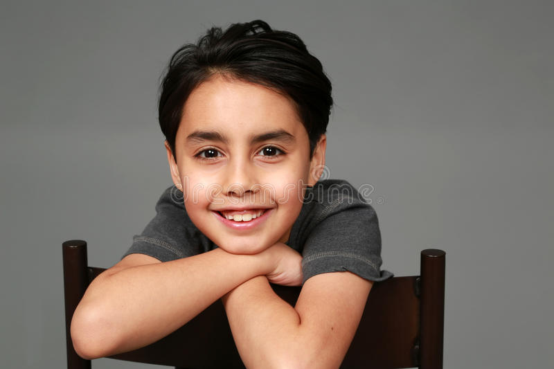 Mixed race boy smiling royalty free stock images