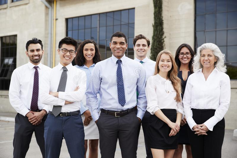 Mixed race businessman and colleagues outdoors, portrait royalty free stock images