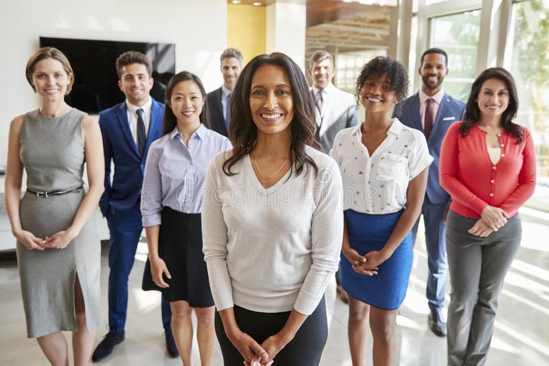 Mixed race businesswoman and business team, group portrait royalty free stock photo