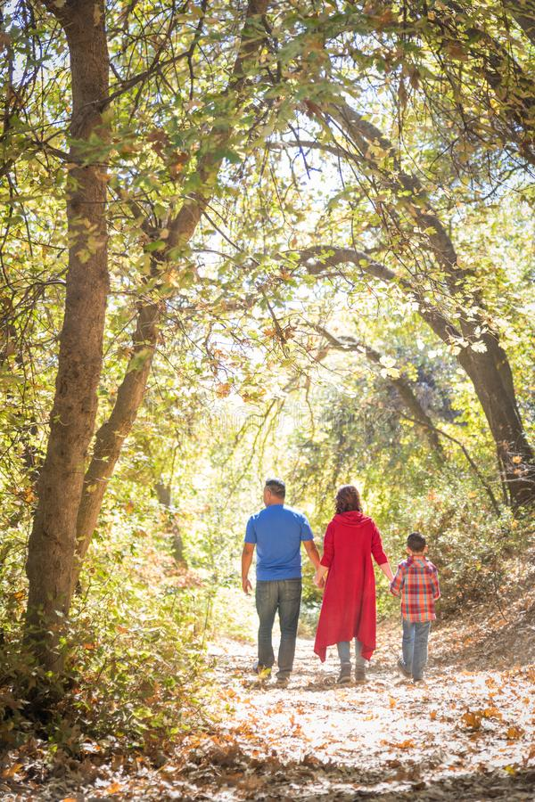 Mixed Race Caucasian and Hispanic Family Exploring the Woods. Mixed Race Caucasian and Hispanic Family Taking a Walk At The Park stock photos