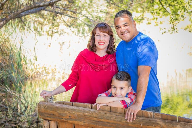 Mixed Race Caucasian and Hispanic Family At The Park. Mixed Race Caucasian and Hispanic Family Outdoors royalty free stock photo