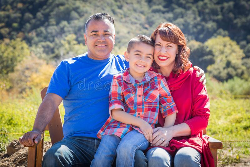 Mixed Race Caucasian and Hispanic Family of Three. Mixed Race Caucasian and Hispanic Family At The Park stock photos
