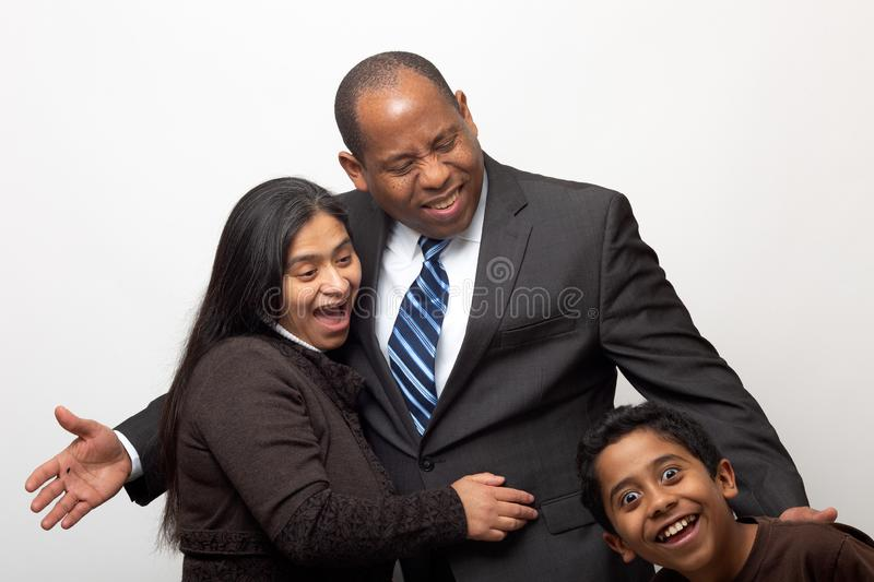 Mixed Race Couple being Photo Bombed by Son royalty free stock images