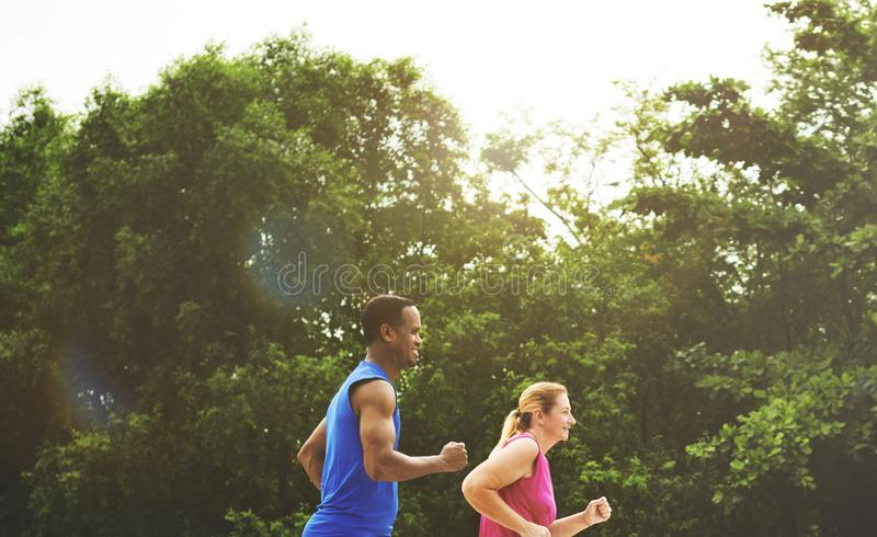 Mixed race couple exercising together in the park royalty free stock photo