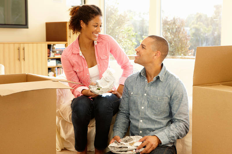 Mixed race couple in new home stock image