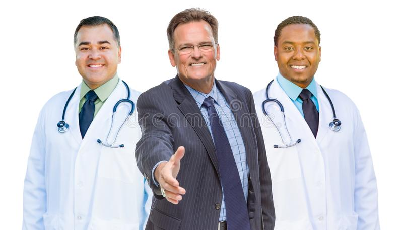 Mixed Race Doctors Behind Businessman Reaching for Hand Shake on. Three Mixed Race Doctors Behind Businessman Reaching for a Hand Shake Isolated on White stock photo