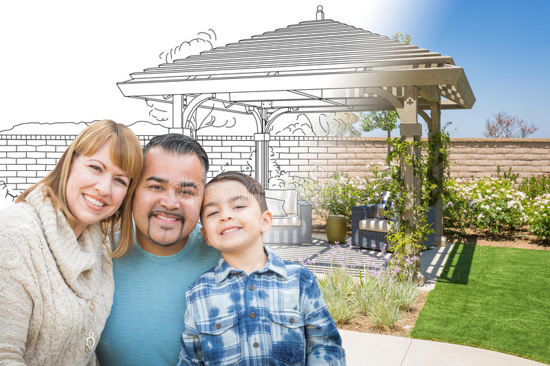 Mixed Race Family In Front of Drawing Gradating Into Photo of Finished Patio Cover. royalty free stock photo
