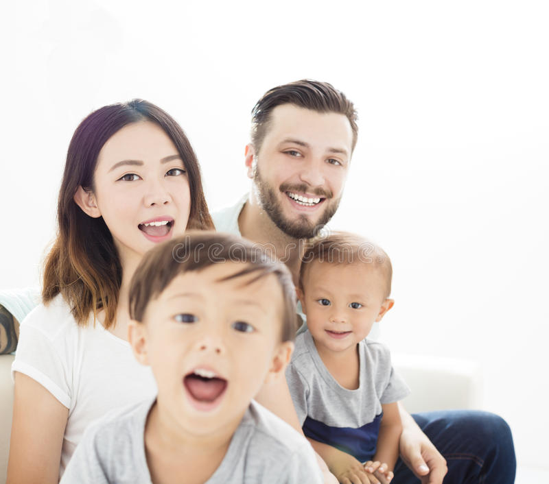 mixed race family in living room royalty free stock photography